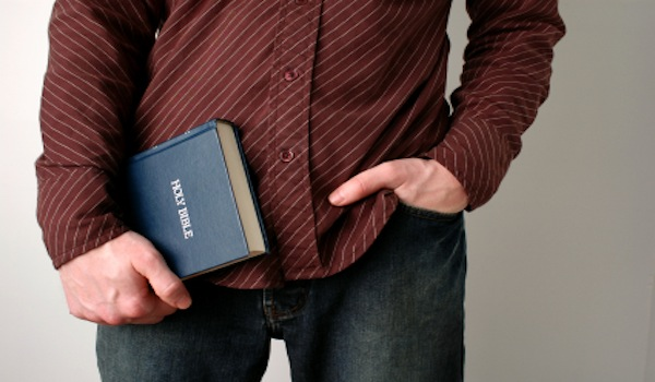 Why go to church - Man holding Bible